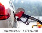 petrol gun with car | Shutterstock . vector #617126090