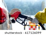 petrol gun with car | Shutterstock . vector #617126099