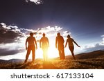 four friends stands in sunset... | Shutterstock . vector #617133104
