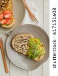 Small photo of Homemade lavish and delicious breakfast toast / Avocado Mushroom Toast / Weekend treats for working couples or families with good nutrition intake for a healthier life