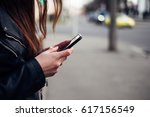 woman using mobile phone | Shutterstock . vector #617156549