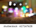 empty wooden table in front of... | Shutterstock . vector #617167628