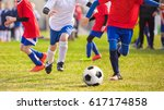 junior football players playing ... | Shutterstock . vector #617174858
