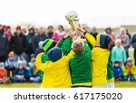 young sport team with trophy.... | Shutterstock . vector #617175020