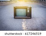 old television on the road | Shutterstock . vector #617246519