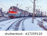Small photo of Freight train moves along Baikal lake. Trans Siberian railway. Russia.