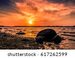sunset at sea shore   Shutterstock . vector #617262599