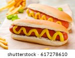 delicious hot dogs with mustard ... | Shutterstock . vector #617278610
