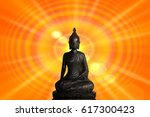 statue of buddha with sun and... | Shutterstock . vector #617300423