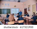 Small photo of schoolchildren sit at their desks during a lesson at classroom in school - Russia Moscow the first High School - April 5 2017