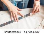 close up. hands woman tailor... | Shutterstock . vector #617361239
