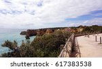 beach of playa de marinha in... | Shutterstock . vector #617383538