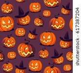 seamless halloween pattern with ... | Shutterstock .eps vector #617387204