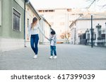 mom and her son walking in a... | Shutterstock . vector #617399039