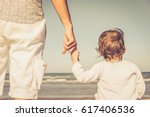 father's hand lead his child... | Shutterstock . vector #617406536