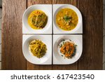 Small photo of Four dishes typical of Bahian cuisine - Brazil. Moqueca, caruru, shrimp bobo and risotto with octopus
