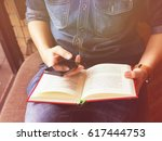 man reading a book and use... | Shutterstock . vector #617444753