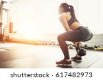 athletic woman exercising with... | Shutterstock . vector #617482973