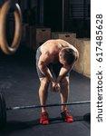 shot of young man in sportswear ... | Shutterstock . vector #617485628