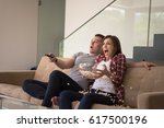 young handsome couple enjoying... | Shutterstock . vector #617500196