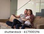 young handsome couple enjoying...   Shutterstock . vector #617500196