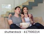 young handsome couple enjoying... | Shutterstock . vector #617500214
