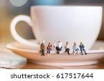 group of miniature people... | Shutterstock . vector #617517644