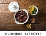 brazilian feijoada food. | Shutterstock . vector #617557664