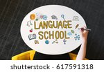 language school text on a white ... | Shutterstock . vector #617591318