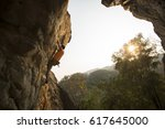 male rock climber with rock... | Shutterstock . vector #617645000