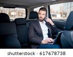 handsome businessman talking...   Shutterstock . vector #617678738