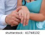 hands newly married with rings... | Shutterstock . vector #61768132
