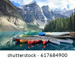Canoes On A Jetty At Moraine...