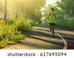 young fitness woman running on... | Shutterstock . vector #617695094
