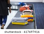 wheeled suitcase on a luggage... | Shutterstock . vector #617697416
