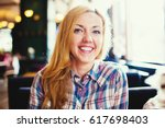 young smiling woman portrait.... | Shutterstock . vector #617698403