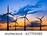 the wind turbines on the... | Shutterstock . vector #617703380