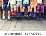 group of diverse kids sitting... | Shutterstock . vector #617727980