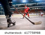 hockey match at rink player in... | Shutterstock . vector #617758988