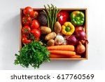 fresh vegetables in wooden box... | Shutterstock . vector #617760569