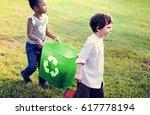 little kids separating recycle... | Shutterstock . vector #617778194