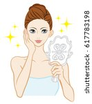 woman looking a hand mirror | Shutterstock .eps vector #617783198