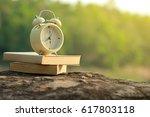 Alarm Clock On Books On The...