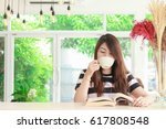 young woman relaxing in cafe ... | Shutterstock . vector #617808548