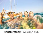 young multiracial friends... | Shutterstock . vector #617814416