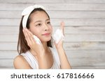 woman washing her face | Shutterstock . vector #617816666