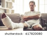 handsome mature man with broken ... | Shutterstock . vector #617820080