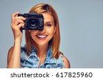 smiling blond female holds...   Shutterstock . vector #617825960