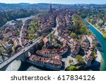 Aerial view of the Bern old town with the Aare river flowing around the town on a sunny day, Bern, Switzerland.