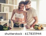 beautiful young couple is... | Shutterstock . vector #617835944